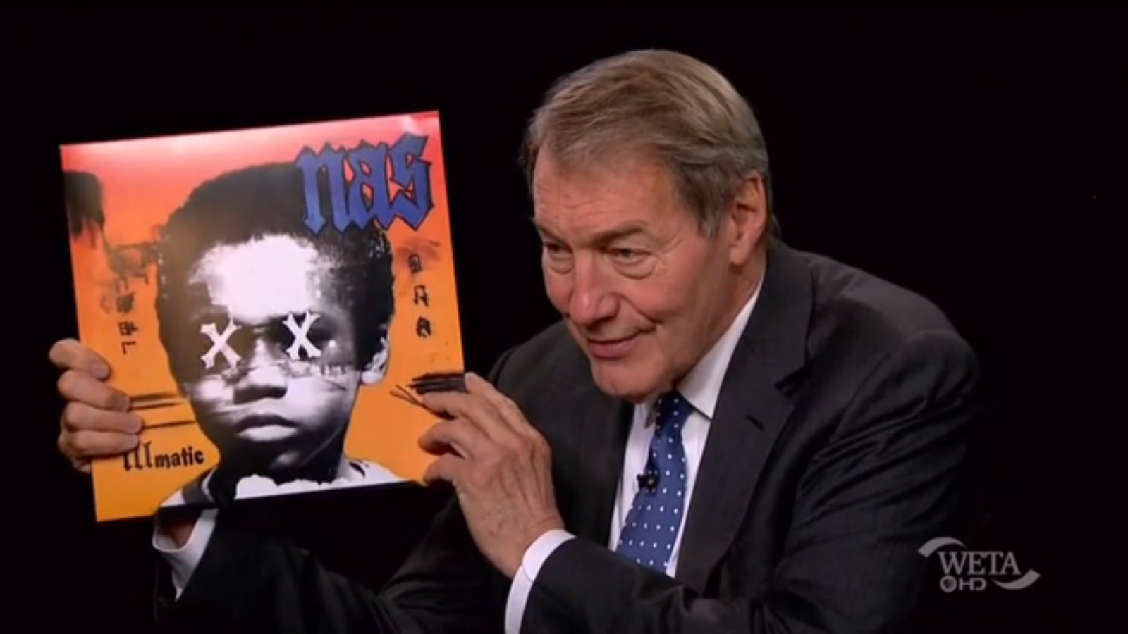 Charlie Hose Holds Illmatic XX while talking to Nas